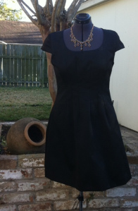 Completed dress pictured against the backyard ruins
